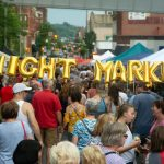 """Image is of people gathered in downtown Greensburg and says """"Night Market"""""""
